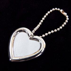 Chaveiro Tiffany & Co em formato de porta retrato coração
