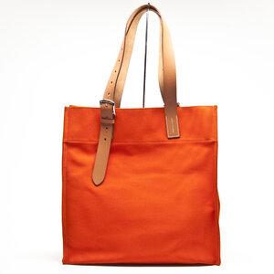 Bolsa Hermès em canvas e couro na cor coral