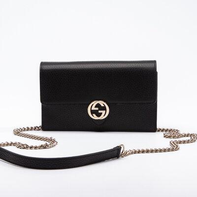Clutch Gucci Dollar Calfskin Interlocking GG Preta