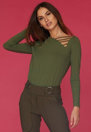 BLUSA ROLOTE LATERAL