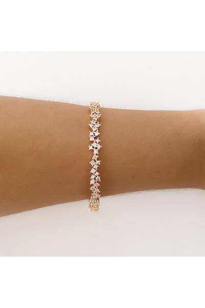 Bracelete dourado com zircônias salpicadas