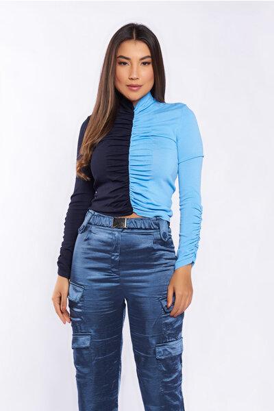 Blusa tricot drapeada bicolor