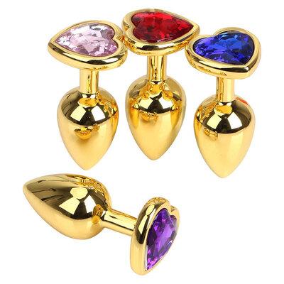 Plug Anal em Aço Dourado com Base em Forma de Coração e Jóia Sortida
