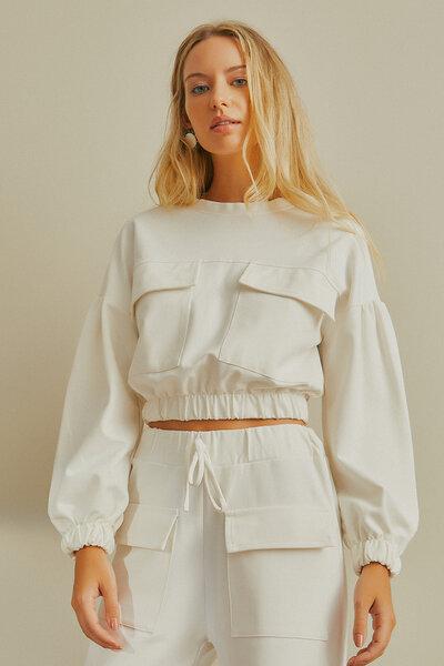 Blusa de malha com bolsos frontais
